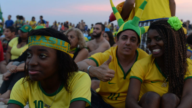 RIO DE JANEIRO, BRAZIL - JUNE 23: Brazilian supporters watch the Brazil vs Cameroon 2014 FIFA World Cup Group A match on the giant screens at the Copacabana Beach in Rio de Janeiro, Brazil,June 23, 2014. Metin Pala / Anadolu Agency