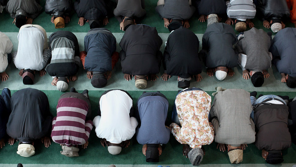 LONDON, ENGLAND - SEPTEMBER 21: Muslim men pray after a speach by the Islamic Khalifa of the Ahmadiyya Muslim community Mirza Masroor Ahmad at Baitul Futuh Mosque in Morden on September 21, 2012 in London, England. More than 5,000 Muslim men and women congregated at the largest mosque in Europe, to listen to the Islamic Khalifa's sermon. A new wave of protests against an anti-Islamic film made in the US denigrating the Prophet Mohammed, have began across the Muslim world today.  (Photo by Dan Kitwood/Getty Images)
