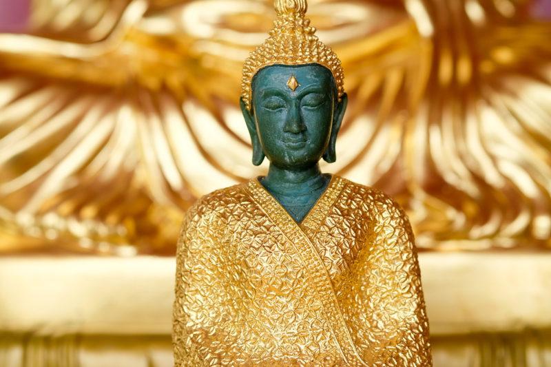Emerald Buddha Close up on gold background