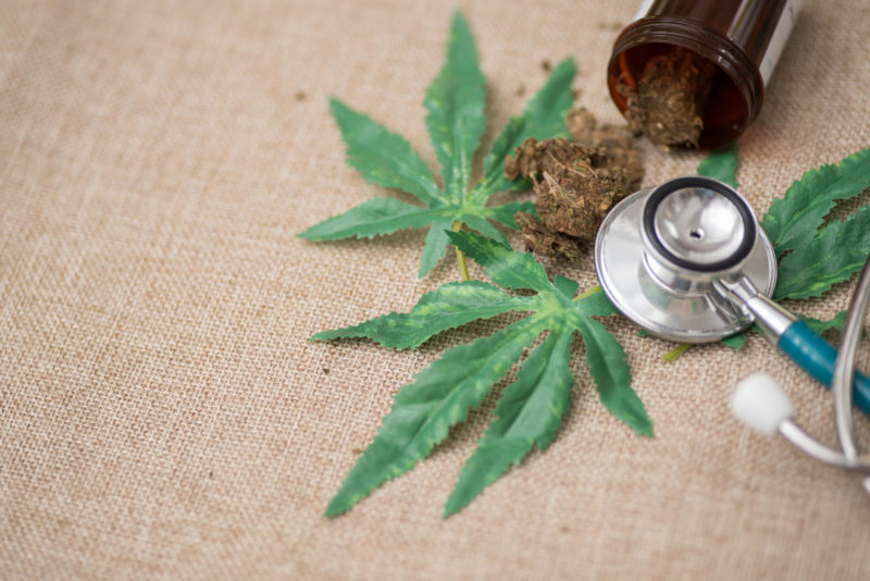 Marijuana leaf and stethoscope.