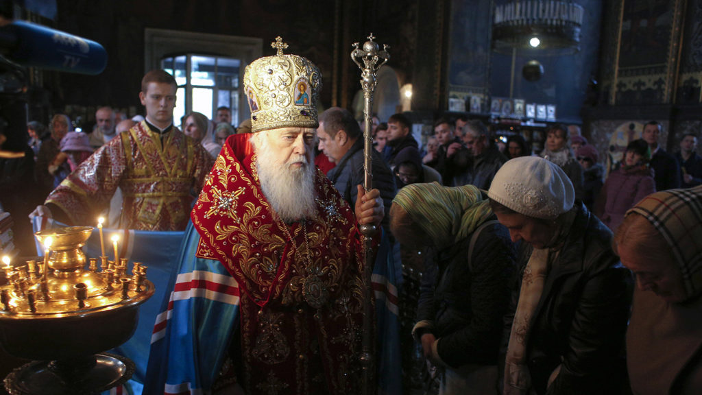 This photograph taken on October 23, 2018, shows Patriarch Filaret (C) of the Ukrainian Orthodox Church of Kiev's Patriarchy conducting a prayer in St. Volodymyr's Cathedral in Kiev. - Patriarch Filaret is months away from turning 90 but the Kiev cleric says he is all in to lead the Ukrainian Orthodox church as it makes a historic break with Moscow. The decision by the Ecumenical Patriarchate of Constantinople drew cheers from Kiev, fury from Moscow, and marked the culmination of more than two decades of work by Filaret. (Photo by Anatolii STEPANOV / AFP)