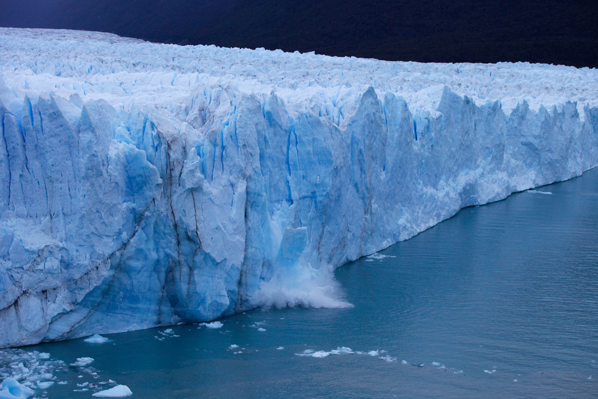 A chunck of ice falls from the Perito Moreno Glacier, at Los Glaciares National Park, near El Calafate in the Argentine province of Santa Cruz, on March 10, 2018.An arch of ice formed at the tip of the Perito Moreno, between the glacier and the shore of Argentino lake, started collapsing into the water on Saturday, a natural display that happens just once every several years. Such arches form roughly every two to four years, when the glacier forms a dam of ice that cuts off the flow of water around it into the lake -- until the water breaks through, opening up a steadily wider tunnel that eventually becomes a narrow arch... and then collapses. / AFP PHOTO / Walter Diaz