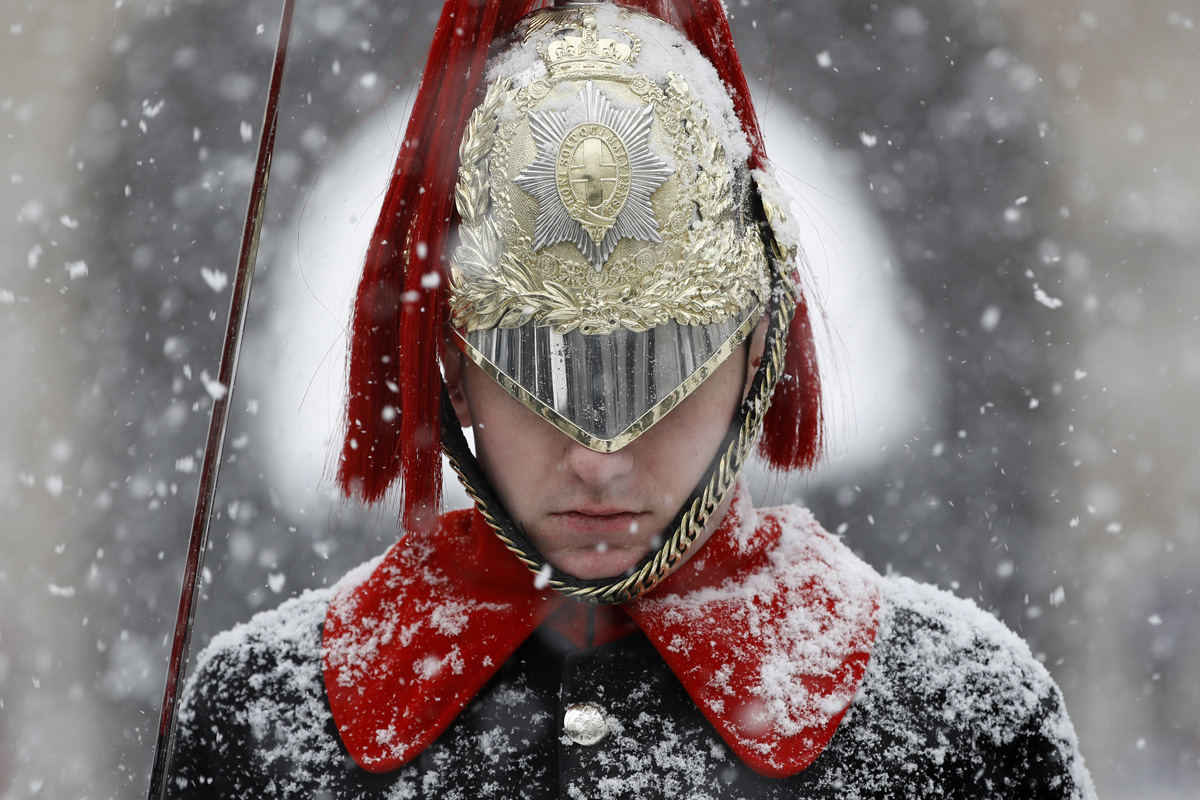 Snow falls on a member of the Household Cavalry Mounted Regiment, on Whitehall in central London on on February 28, 2018.Europe remained Wednesday gripped by a blast of Siberian weather which has killed at least 24 people and carpeted palm-lined Mediterranean beaches in snow. / AFP PHOTO / Tolga AKMEN