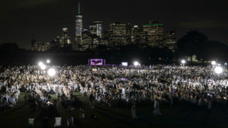 Diner En Blanc, a secret pop-up dinner, is held this year on Governors Island in New York, U.S., September 17, 2018.  REUTERS/Stephen Yang