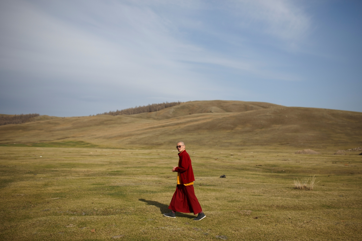 """Senior Buddhist monk Lobsang Tayang walks outside the Amarbayasgalant Monastery in the Baruunburen district, Selenge province, Mongolia, April 26, 2018. REUTERS/Thomas Peter  SEARCH """"MILLENNIAL MONKS"""" FOR THIS STORY. SEARCH """"WIDER IMAGE"""" FOR ALL STORIES. TPX IMAGES OF THE DAY."""