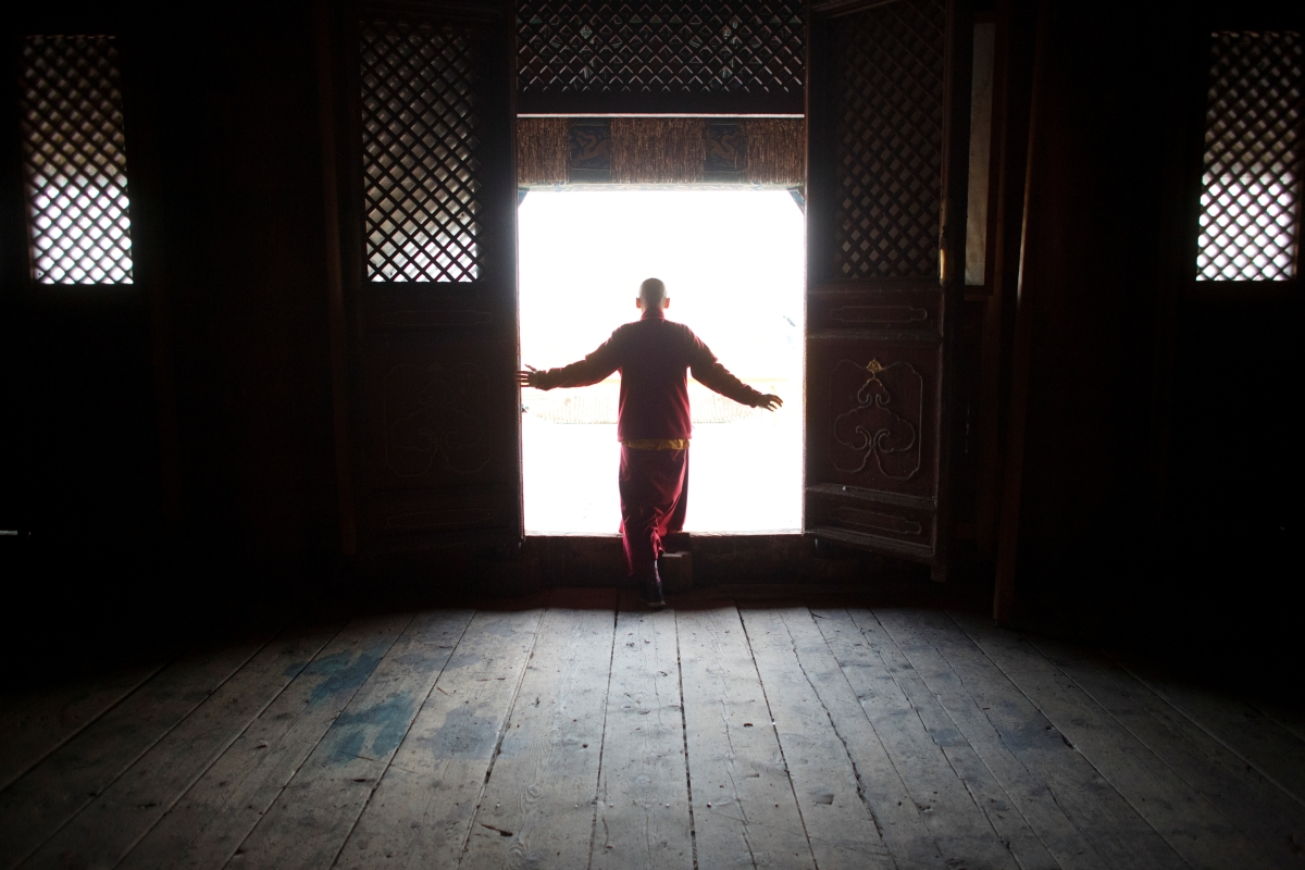 """Senior Buddhist monk Lobsang Tayang steps out onto the terrace of the main temple at the Amarbayasgalant Monastery in the Baruunburen district, Selenge province, Mongolia, April 26, 2018. REUTERS/Thomas Peter  SEARCH """"MILLENNIAL MONKS"""" FOR THIS STORY. SEARCH """"WIDER IMAGE"""" FOR ALL STORIES."""