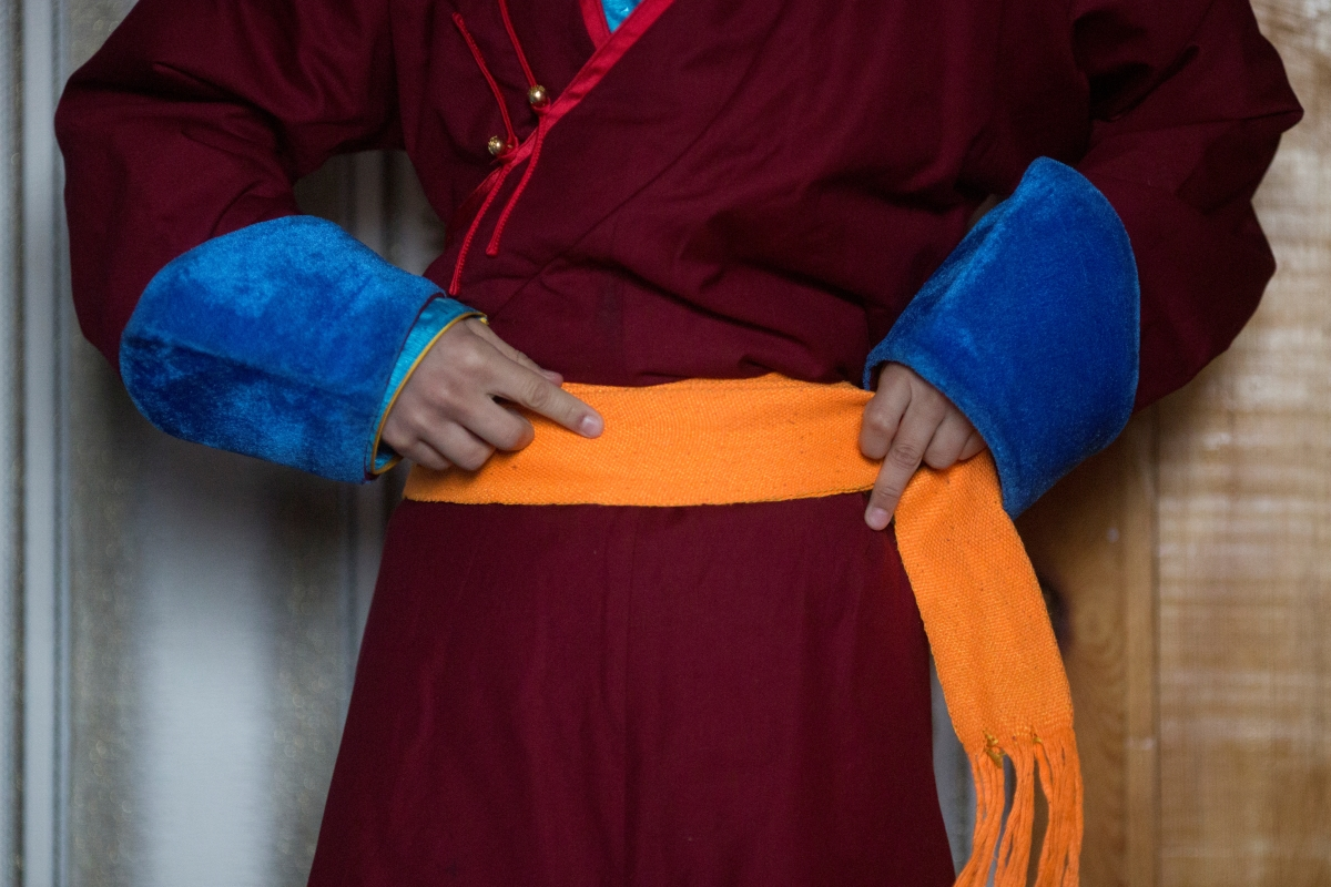 """Young Buddhist monk Temuulen ties his belt after getting up in his room at the Amarbayasgalant Monastery in the Baruunburen district, Selenge province, Mongolia, April 26, 2018. REUTERS/Thomas Peter  SEARCH """"MILLENNIAL MONKS"""" FOR THIS STORY. SEARCH """"WIDER IMAGE"""" FOR ALL STORIES."""