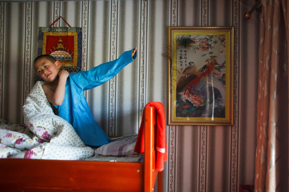 """Young Buddhist monk Temuulen gets dressed after waking up at 7am in his room at the Amarbayasgalant Monastery in the Baruunburen district, Selenge province, Mongolia, April 26, 2018. REUTERS/Thomas Peter  SEARCH """"MILLENNIAL MONKS"""" FOR THIS STORY. SEARCH """"WIDER IMAGE"""" FOR ALL STORIES."""