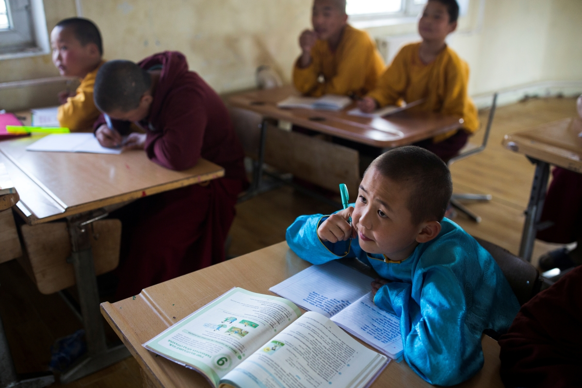 """Young Buddhist monk Temuulen attends a lesson at the Amarbayasgalant Monastery in the Baruunburen district, Selenge province, Mongolia, April 26, 2018. REUTERS/Thomas Peter   SEARCH """"MILLENNIAL MONKS"""" FOR THIS STORY. SEARCH """"WIDER IMAGE"""" FOR ALL STORIES."""