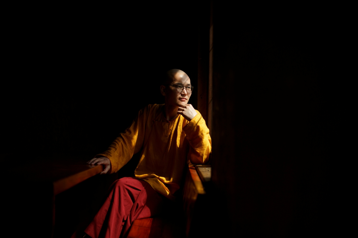 """Senior Buddhist monk Lobsang Tayang poses for a picture at the Amarbayasgalant Monastery in the Baruunburen district, Selenge province, Mongolia, April 26, 2018. REUTERS/Thomas Peter  SEARCH """"MILLENNIAL MONKS"""" FOR THIS STORY. SEARCH """"WIDER IMAGE"""" FOR ALL STORIES. TPX IMAGES OF THE DAY."""