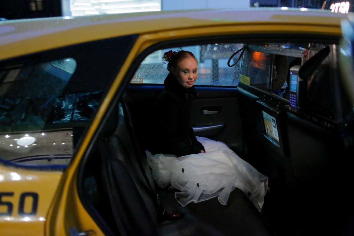 """Model Madeline Stuart sits in the back of a taxi cab after walking in a runway show during New York Fashion Week in New York City, U.S., September 9, 2018. REUTERS/Andrew Kelly  SEARCH """"MODEL MADELINE"""" FOR THIS STORY. SEARCH """"WIDER IMAGE"""" FOR ALL STORIES.  TPX IMAGES OF THE DAY.  THE IMAGES SHOULD ONLY BE USED TOGETHER WITH THE STORY - NO STAND-ALONE USES"""