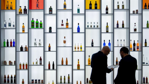 13 November 2018, Bavaria, Nürnberg: Numerous bottles will be on display on a shelf with background lighting at the stand of the US manufacturer of glass containers OI (Owens-Illinois) at the BrauBeviale beverage trade fair. Photo: Daniel Karmann/dpa