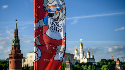 A photograph taken on May 30, 2018  shows the FIFA World Cup 2018 flag featuring the tournament's mascot Zabivaka in front of the Kremlin in Moscow.The FIFA World Cup 2018 tournament kicks off on June 14, 2018. / AFP PHOTO / Mladen ANTONOV