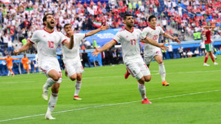 (L-R) Iran's forward Karim Ansari Fard, Iran's forward Mehdi Taremi and Iran's forward Sardar Azmoun reacts after Morocco scored an own goal during the Russia 2018 World Cup Group B football match between Morocco and Iran at the Saint Petersburg Stadium in Saint Petersburg on June 15, 2018. / AFP PHOTO / Giuseppe CACACE / RESTRICTED TO EDITORIAL USE - NO MOBILE PUSH ALERTS/DOWNLOADS