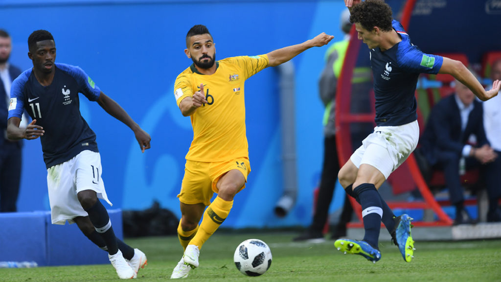 France's defender Benjamin Pavard (R) vies for the ball with Australia's defender Aziz Behich (C) during the Russia 2018 World Cup Group C football match between France and Australia at the Kazan Arena in Kazan on June 16, 2018. / AFP PHOTO / Kirill KUDRYAVTSEV / RESTRICTED TO EDITORIAL USE - NO MOBILE PUSH ALERTS/DOWNLOADS