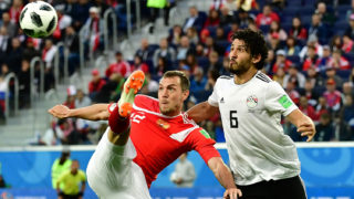 Egypt's defender Ahmed Hegazi (R) vies with Russia's forward Artem Dzyuba during the Russia 2018 World Cup Group A football match between Russia and Egypt at the Saint Petersburg Stadium in Saint Petersburg on June 19, 2018.  / AFP PHOTO / Giuseppe CACACE / RESTRICTED TO EDITORIAL USE - NO MOBILE PUSH ALERTS/DOWNLOADS