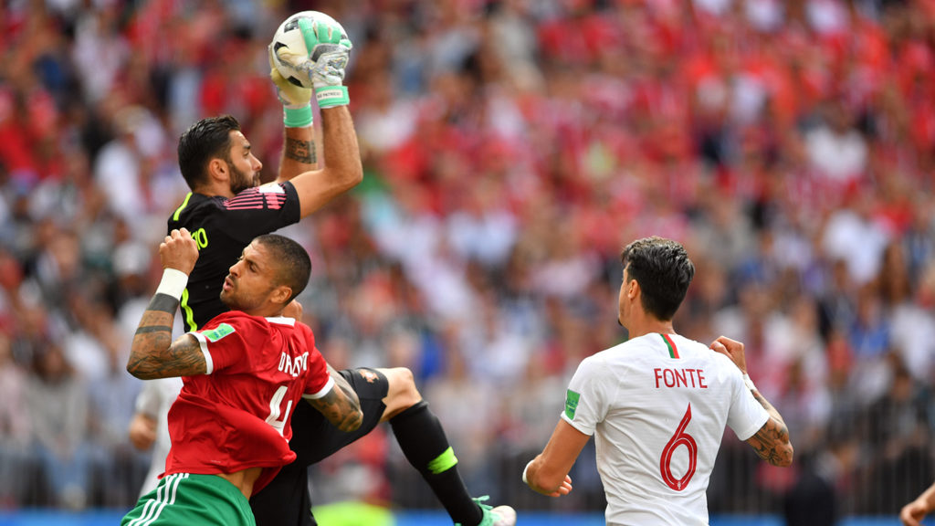 Portugal's goalkeeper Rui Patricio (back L) saves a shot on goal by Morocco's defender Manuel Da Costa during the Russia 2018 World Cup Group B football match between Portugal and Morocco at the Luzhniki Stadium in Moscow on June 20, 2018. / AFP PHOTO / Yuri CORTEZ / RESTRICTED TO EDITORIAL USE - NO MOBILE PUSH ALERTS/DOWNLOADS