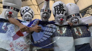 Disguised Japan's fans gesture as they pose before the Russia 2018 World Cup Group H football match between Japan and Poland at the Volgograd Arena in Volgograd on June 28, 2018. / AFP PHOTO / PHILIPPE DESMAZES / RESTRICTED TO EDITORIAL USE - NO MOBILE PUSH ALERTS/DOWNLOADS