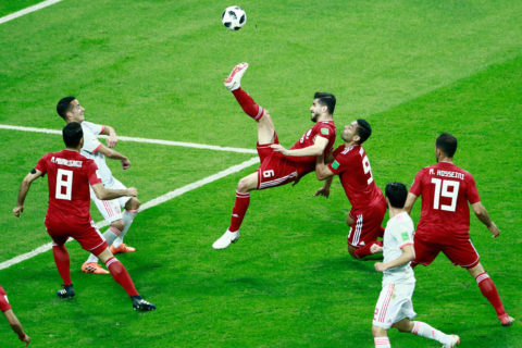 Iran's midfielder Saeid Ezatolahi (C) clears the ball during the Russia 2018 World Cup Group B football match between Iran and Spain at the Kazan Arena in Kazan on June 20, 2018. / AFP PHOTO / BENJAMIN CREMEL / RESTRICTED TO EDITORIAL USE - NO MOBILE PUSH ALERTS/DOWNLOADS