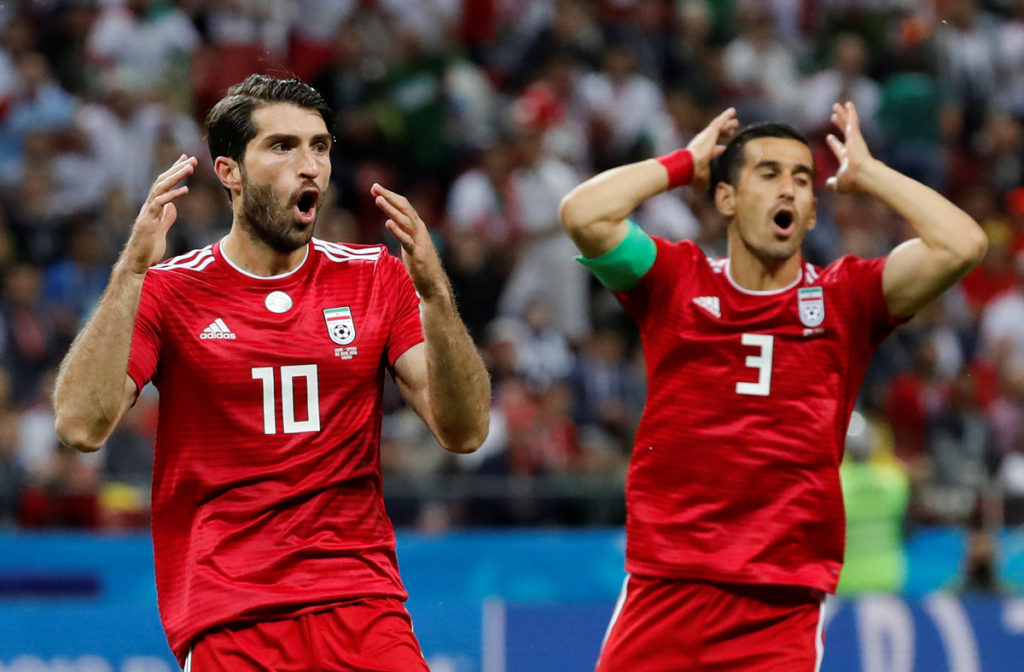 Soccer Football - World Cup - Group B - Iran vs Spain - Kazan Arena, Kazan, Russia - June 20, 2018   Iran's Ehsan Hajsafi and Karim Ansarifard react    REUTERS/Toru Hanai