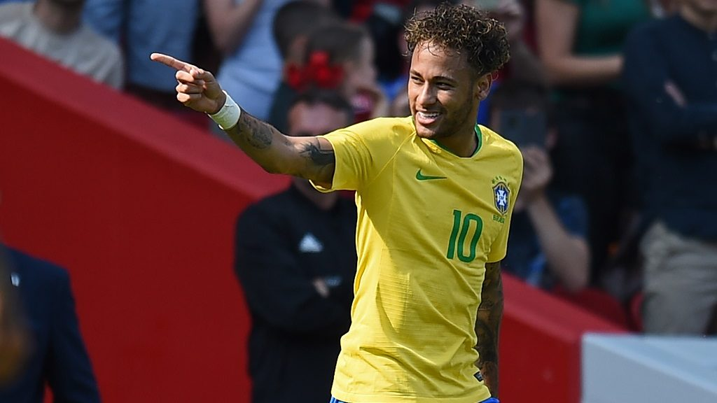 Brazil's striker Neymar celebrates after scoring the opening goal of the International friendly football match between Brazil and Croatia at Anfield in Liverpool on June 3, 2018. / AFP PHOTO / Oli SCARFF