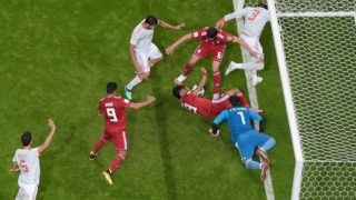 Players vie for the loose ball during the Russia 2018 World Cup Group B football match between Iran and Spain at the Kazan Arena in Kazan on June 20, 2018. / AFP PHOTO / - / RESTRICTED TO EDITORIAL USE - NO MOBILE PUSH ALERTS/DOWNLOADS