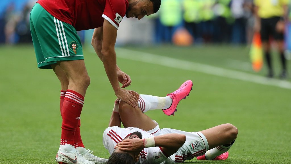 Romain Saiss (L) of the Morocco national football team and Ramin Rezaeian of the Iran national football team vie for the ball during the 2018 FIFA World Cup match, first stage - Group B between Morocco and Iran at Saint Petersburg Stadium on June 15, 2018 in St. Petersburg, Russia. (Photo by Igor Russak/NurPhoto)