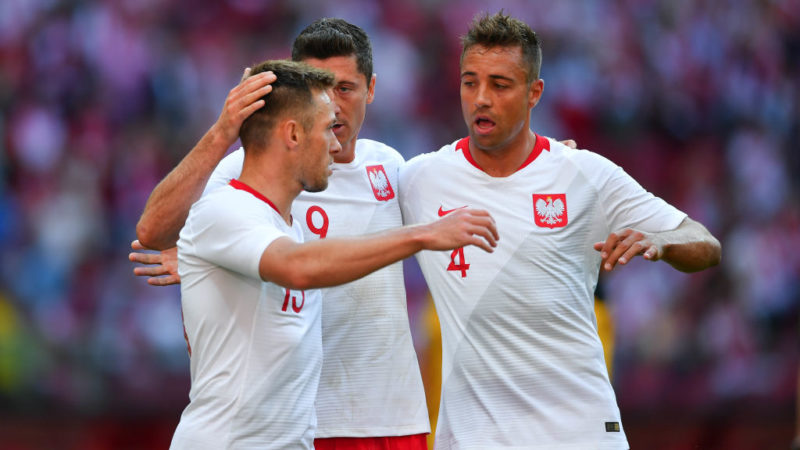 WARSAW, POLAND - JUNE 12: Robert Lewandowski of Poland celebrates scoring a goal with team mates during International Friendly match between Poland and Lithuania on June 12, 2018 in Warsaw, Poland. (Photo by Pawel Andrachiewicz/PressFocus/MB Media/Getty Images)
