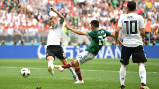 MOSCOW, RUSSIA - JUNE 17:  Hirving Lozano of Mexico scores his team's first goal during the 2018 FIFA World Cup Russia group F match between Germany and Mexico at Luzhniki Stadium on June 17, 2018 in Moscow, Russia.  (Photo by Dan Mullan/Getty Images)