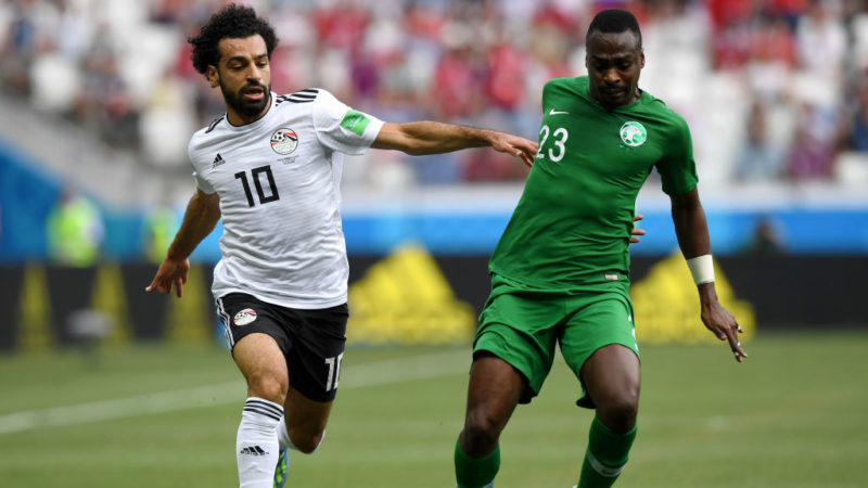 VOLGOGRAD, RUSSIA - JUNE 25:  Motaz Hawsawi of Saudi Arabia is challenged by Mohamed Salah of Egypt during the 2018 FIFA World Cup Russia group A match between Saudia Arabia and Egypt at Volgograd Arena on June 25, 2018 in Volgograd, Russia.  (Photo by Shaun Botterill/Getty Images)