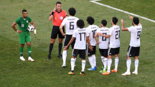 VOLGOGRAD, RUSSIA - JUNE 25:  Referee Wilmar Roldan is surrounded by Egypt players as he checks with VAR concerning a penalty for Saudi Arabia during the 2018 FIFA World Cup Russia group A match between Saudia Arabia and Egypt at Volgograd Arena on June 25, 2018 in Volgograd, Russia.  (Photo by Laurence Griffiths/Getty Images)