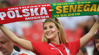 A Poland fan cheers before the Russia 2018 World Cup Group H football match between Poland and Senegal at the Spartak Stadium in Moscow on June 19, 2018. / AFP PHOTO / Patrik STOLLARZ / RESTRICTED TO EDITORIAL USE - NO MOBILE PUSH ALERTS/DOWNLOADS
