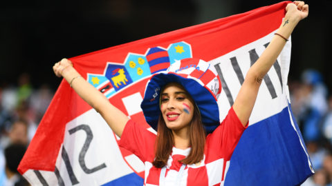 A Croatia's fan dispalys a national flag as she waits in the grandstand before the Russia 2018 World Cup Group D football match between Argentina and Croatia at the Nizhny Novgorod Stadium in Nizhny Novgorod on June 21, 2018. / AFP PHOTO / Johannes EISELE / RESTRICTED TO EDITORIAL USE - NO MOBILE PUSH ALERTS/DOWNLOADS