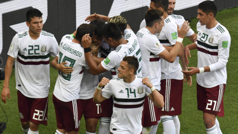Mexico's forward Carlos Vela (C) with team-mates after scoring a penalty for the opening goal during the Russia 2018 World Cup Group F football match between South Korea and Mexico at the Rostov Arena in Rostov-On-Don on June 23, 2018. / AFP PHOTO / PASCAL GUYOT / RESTRICTED TO EDITORIAL USE - NO MOBILE PUSH ALERTS/DOWNLOADS