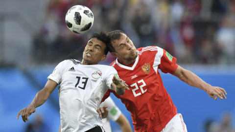 Egypt's defender Mohamed Abdel-Shafy (L) and Russia's forward Artem Dzyuba vie during the Russia 2018 World Cup Group A football match between Russia and Egypt at the Saint Petersburg Stadium in Saint Petersburg on June 19, 2018.  / AFP PHOTO / GABRIEL BOUYS / RESTRICTED TO EDITORIAL USE - NO MOBILE PUSH ALERTS/DOWNLOADS