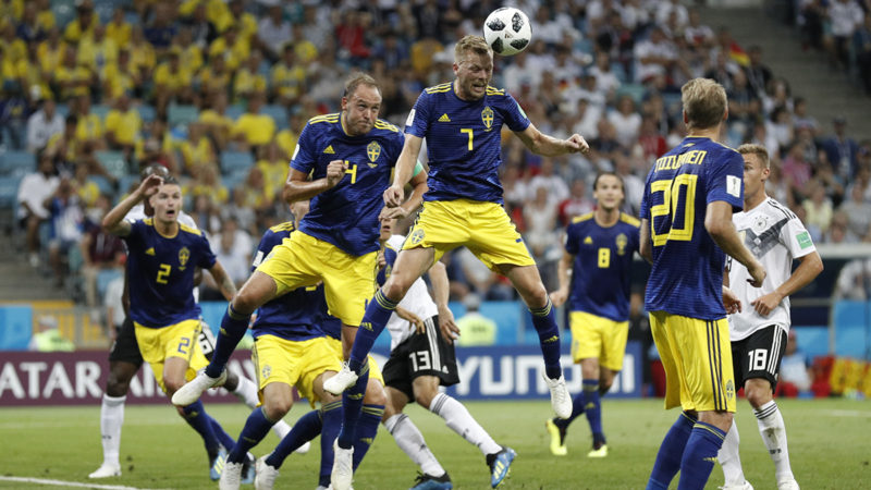 Sweden's midfielder Sebastian Larsson heads the ball during the Russia 2018 World Cup Group F football match between Germany and Sweden at the Fisht Stadium in Sochi on June 23, 2018. / AFP PHOTO / Adrian DENNIS / RESTRICTED TO EDITORIAL USE - NO MOBILE PUSH ALERTS/DOWNLOADS
