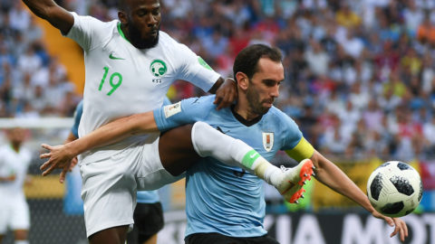 Saudi Arabia's forward Fahad Al-Muwallad (L) vies with Uruguay's defender Diego Godin during the Russia 2018 World Cup Group A football match between Uruguay and Saudi Arabia at the Rostov Arena in Rostov-On-Don on June 20, 2018. / AFP PHOTO / Khaled DESOUKI / RESTRICTED TO EDITORIAL USE - NO MOBILE PUSH ALERTS/DOWNLOADS