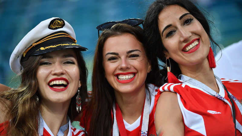 Russia supporters wait for the start of the Russia 2018 World Cup quarter-final football match between Russia and Croatia at the Fisht Stadium in Sochi on July 7, 2018. / AFP PHOTO / Nelson Almeida / RESTRICTED TO EDITORIAL USE - NO MOBILE PUSH ALERTS/DOWNLOADS