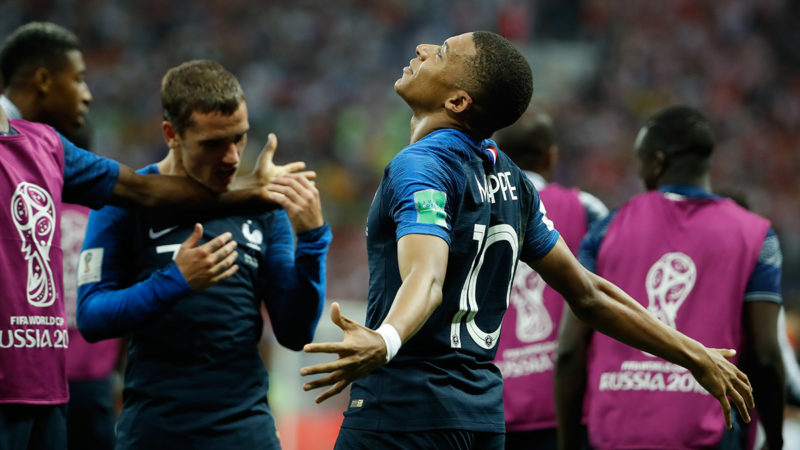 France's forward Kylian Mbappe celebrates scoring the 4-1 goal during the Russia 2018 World Cup final football match between France and Croatia at the Luzhniki Stadium in Moscow on July 15, 2018. / AFP PHOTO / Odd ANDERSEN / RESTRICTED TO EDITORIAL USE - NO MOBILE PUSH ALERTS/DOWNLOADS