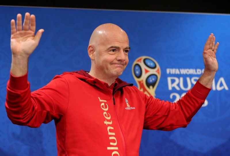 13 July 2018, Russia, Moscow: Soccer, World Cup. FIFAPresident Gianni Infantino (C) coming to a press conference. Photo: Christian Charisius/dpa