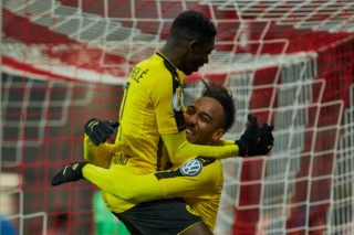 MUNICH, GERMANY - APRIL 26: Pierre-Emerick Aubameyang of Dortmund celebrates after scoring his team`s second goal with Ousmane Dembele of Dortmund during the German Cup (DFB Cup) semi final soccer match between FC Bayern Munich and Borussia Dortmund at the Allianz Arena on April 26, 2017, in Munich, Germany. (Photo by TF-Images/Getty Images)