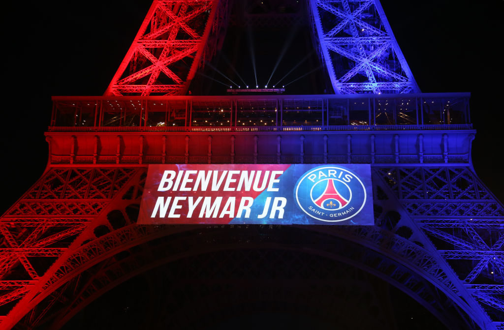 PARIS, FRANCE - AUGUST 5: The Eiffel Tower is illuminated with the colors of Paris Saint-Germain and welcome Neymar Jr following the French Ligue 1 match between Paris Saint Germain (PSG) and Amiens SC at Parc des Princes on August 5, 2017 in Paris, . (Photo by Jean Catuffe/Getty Images)