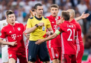 MADRID, SPAIN - APRIL 18: Players of FC Bayern Munich argue with referee Viktor Kassai during their 2016-17 UEFA Champions League Quarter-finals second leg match between Real Madrid and FC Bayern Munich at the Estadio Santiago Bernabeu on 18 April 2017 in Madrid, Spain. (Photo by Power Sport Images/Getty Images)