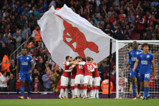 LONDON, ENGLAND - AUGUST 11:  Alexandre Lacazette (obscured) of Arsenal celebrates with teammates after scoring the opening goal during the Premier League match between Arsenal and Leicester City at the Emirates Stadium on August 11, 2017 in London, England.  (Photo by Shaun Botterill/Getty Images)