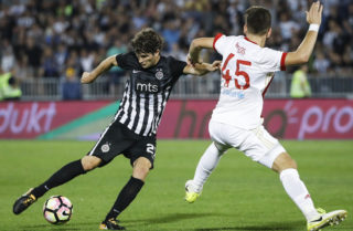 BELGRADE, SERBIA - JULY 25: Nebojsa Kosovic (L) of Partizan in action against Panagiotis Retsos (R) of Olympiacos during the UEFA Champions League Qualifying match between FC Partizan and Olympiacos on July 25, 2017 in Belgrade, Serbia. (Photo by Srdjan Stevanovic/Getty Images)