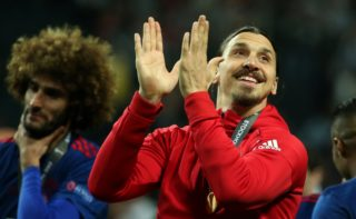 Manchester United's injured Swedish striker Zlatan Ibrahimovic (R) celebrates after his team won the UEFA Europa League final football match Ajax Amsterdam v Manchester United on May 24, 2017 at the Friends Arena in Solna outside Stockholm. / AFP PHOTO / Soren Andersson