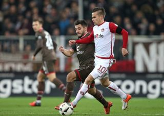 HAMBURG, GERMANY - DECEMBER 02: Cenk Sahin of St.Pauli and Zoltan Stieber of Kaiserslautern battle for the ball during the Second Bundesliga match between FC St. Pauli and 1. FC Kaiserslautern at Millerntor Stadium on December 2, 2016 in Hamburg, Germany. (Photo by TF-Images/Getty Images)