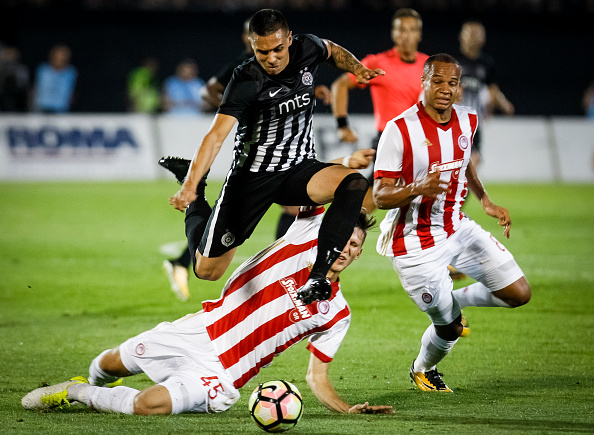 BELGRADE, SERBIA - JULY 25: Uros Djurdjevic (TOP) of Partizan in action against Panagiotis Retsos (DOWN) and Vadis Odjidja (R) of Olympiacos during the UEFA Champions League Qualifying match between FC Partizan and Olympiacos on July 25, 2017 in Belgrade, Serbia. (Photo by Srdjan Stevanovic/Getty Images)