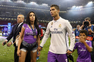 CARDIFF, WALES - JUNE 03:  Cristiano Ronaldo of Real Madrid walks with girlfriend Georgina Rodriguez and son Cristiano Jnr at the end of the UEFA Champions League Final between Juventus and Real Madrid at National Stadium of Wales on June 3, 2017 in Cardiff, Wales.  (Photo by Matthew Ashton - AMA/Getty Images)