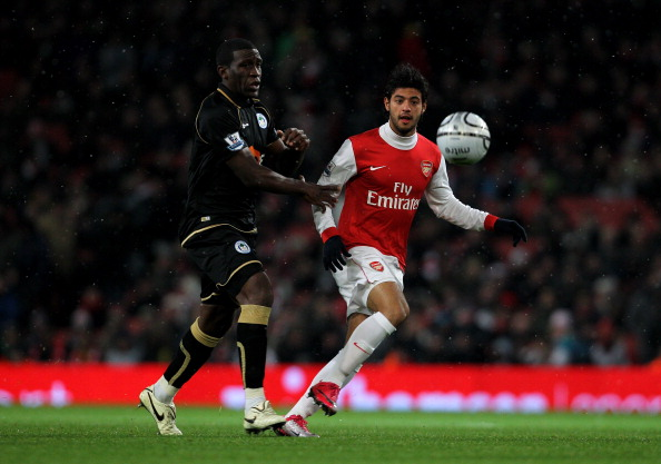LONDON, ENGLAND - NOVEMBER 30: Hendry Thomas (L) of Wigan in action against Carlos Vela of Arsenal during the Carling Cup quarter final match between Arsenal and Wigan Athletic at the Emirates Stadium on November 30, 2010 in London, England.  (Photo by Clive Rose/Getty Images)